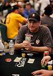 Mike Matusow puts money on the table to place a bet as to what other players actions will be.
