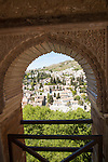 View through Alhambra window archway to Moorish houses in the Albaicin district of Granada, Spain