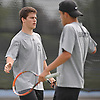 Daniel Shleimovich, left, and Dylan Granat of Syosset slap hands after a taking a point in the the Nassau County varsity boys' tennis doubles championship match against Sean Mullins and Patrick Hannity of Cold Spring Harbor at Oceanside High School on Satuday, May 16, 2015.<br /> <br /> James Escher