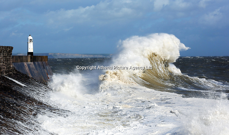 WINDY WEATHER WALES<br /> Pictured: Waves batter the promenade wall of the lighthouse in Porthcawl, south Wales, UK. Tuesday 06 June 2017<br /> Re: Strong winds have been affecting parts of the UK