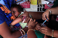 A child receives an immunisation at an Anganwadi nutrition centre in the village of Badnavar, Madhya Pradesh, India.<br />