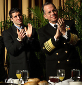 Heisman Trophy-winning football star Tim Tebow (left) and Chairman, United States Joint Chiefs of Staff Admiral Michael Mullen applaud during the 58th National Prayer Breakfast at the Washington Hilton Hotel, Washington, DC, Thursday, February 4, 2010..Credit: Martin H. Simon - Pool via CNP