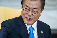 Korean President Moon Jae-in listens to US President Donald J. Trump (not pictured) speak in the Oval Office of the White House in Washington, DC, USA, 11 April 2019. President Moon is expected to ask President Trump to reduce sanctions on North Korea in an attempt to jump start nuclear negotiations between North Korea and the US.<br /> CAP/MPI/RS<br /> ©RS/MPI/Capital Pictures