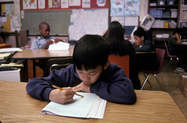 Oakland CA 5th grader taking standardized city reading test in class