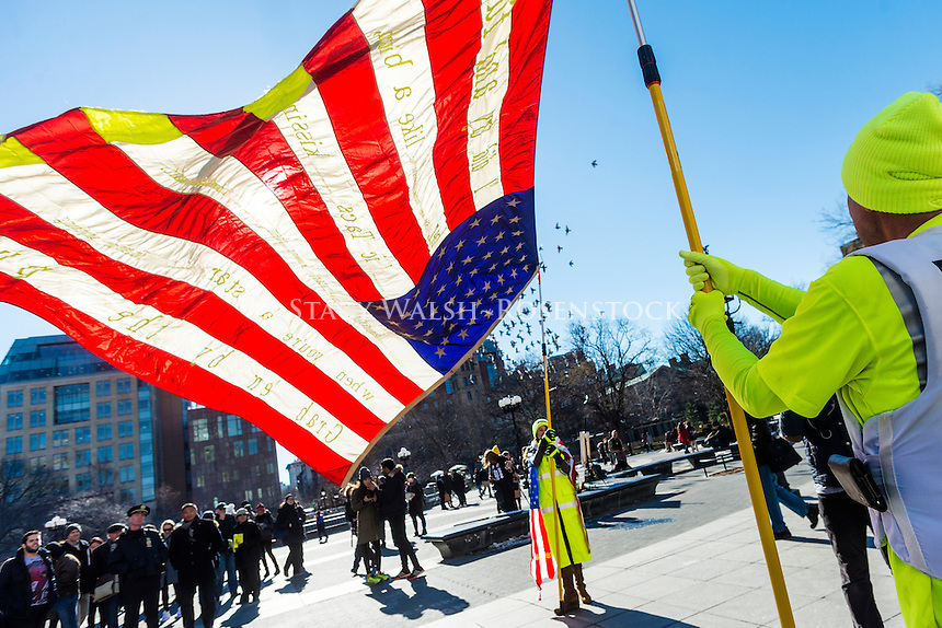 New York, USA 17 February 2017 - Activists rallied in Washington Square, in solidary with the  General Strike, to protest Trump Administration and their anti-democratic policies. the Art Response Team waves a giant American Flag near Washington Arch. ©Stacy Walsh Rosenstock/ALamy Live News