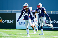 August 1, 2017: New England Patriots cornerback Stephon Gilmore (24) warms up at the New England Patriots training camp held at Gillette Stadium, in Foxborough, Massachusetts. Eric Canha/CSM
