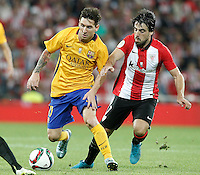 Athletic de Bilbao's Benat Etxebarria (r) and FC Barcelona's Leo Messi during Supercup of Spain 1st match.August 14,2015. (ALTERPHOTOS/Acero)