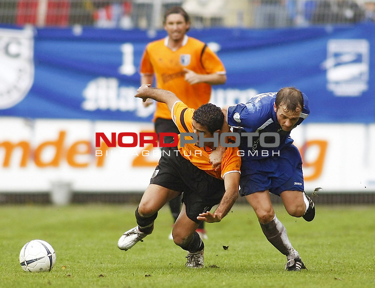 RLN 2007/2008 12. Spieltag Hinrunde<br /> BSV Kickers Emden -  1. FC Magdeburg<br /> Am Boden: Kais Manai (Magdeburg#10) Thorsten Nehrbauer (Kickers#5) stolpert<br /> Foto &copy; nph (  nordphoto  )<br /> <br /> <br /> <br />  *** Local Caption ***