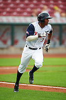 Cedar Rapids Kernels outfielder Edgar Corcino (36) runs to first during a game against the Kane County Cougars on August 18, 2015 at Perfect Game Field in Cedar Rapids, Iowa.  Kane County defeated Cedar Rapids 1-0.  (Mike Janes/Four Seam Images)