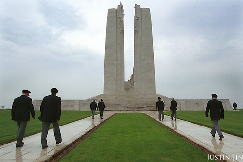 Canadian war veterans walk towards the memorial...Photo taken 10 May 2000 at the Canadian War Memorial at Vimy, France..Credit: Justin Jin
