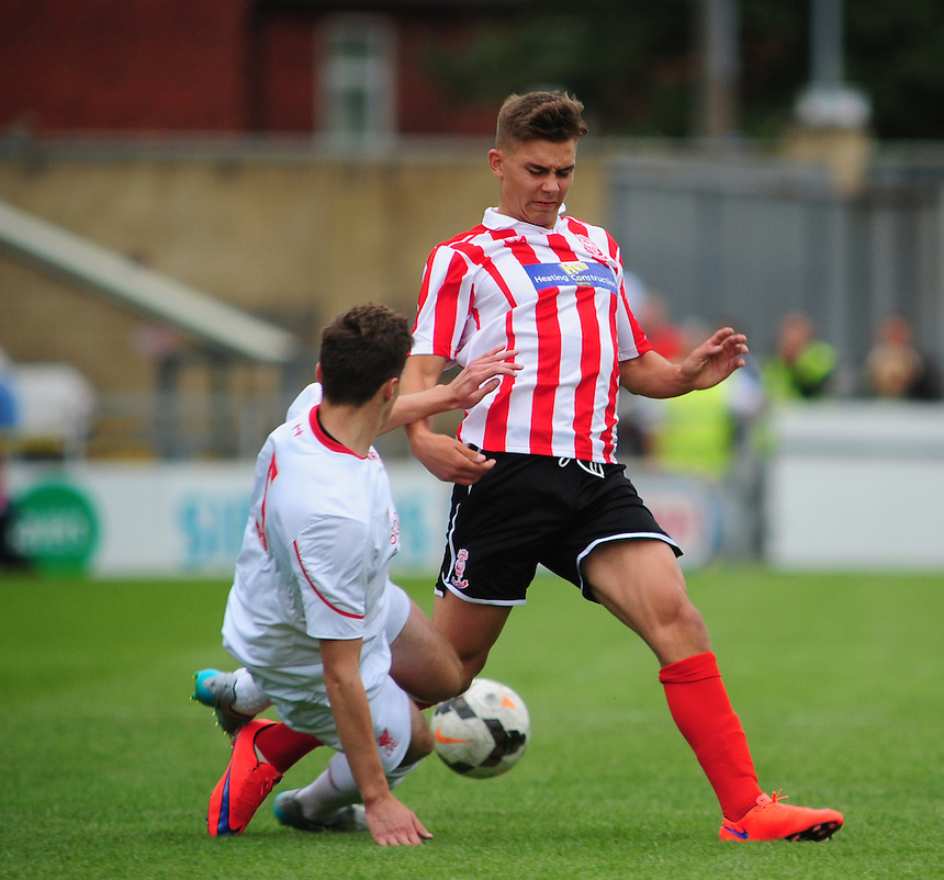 Liverpool U18's Conor Masterson gets a challenge in on Lincoln City U18's Jack McMenemy<br /> <br /> Photographer Andrew Vaughan/CameraSport<br /> <br /> Football - Football Friendly - Lincoln City U18 v Liverpool U18 - Thursday 23rd July 2015 - Sincil Bank - Lincoln<br /> <br /> &copy; CameraSport - 43 Linden Ave. Countesthorpe. Leicester. England. LE8 5PG - Tel: +44 (0) 116 277 4147 - admin@camerasport.com - www.camerasport.com