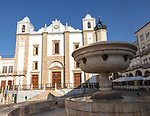 Fountain and Sixteenth century building of Church of Santo Antão dating from 1557, Giraldo Square, Praça do Giraldo, Evora, Alto Alentejo, Portugal southern Europe