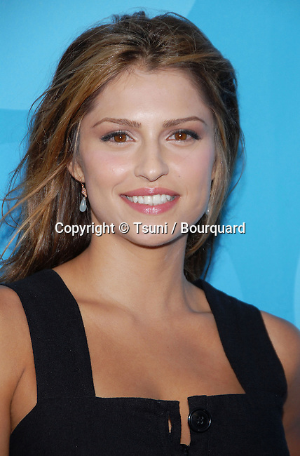 Raquel Alessi arriving at the FOX tca Summer party at the Ritz Carlton In Los Angeles. July 25, 2006.<br /> <br /> eye contact<br /> headshot<br /> smile