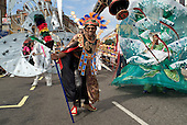 Members of Flamboyan Carnival Arts parade in costume at Notting Hill Carnival, London