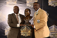 Canton, Ohio - August 6, 2015: Former NFL player Tim Brown poses with his brother, Donald Kelly, and his bust during the 2015 Pro Football Hall of Fame enshrinement in Canton, Ohio August 6, 2015. At time of his retirement, Brown amassed 14,934 receiving yards, second-highest total in NFL history. (Photo by Don Baxter/Media Images International)
