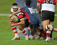 Scots' Caleb Mahenie is wrapped up the Hurricanes 1st XV Secondary Schools rugby match between Scots College and Hastings Boys' High School at Porirua Park, Porirua, Wellington, New Zealand on Friday, 17 May 2013. Photo: Dave Lintott / lintottphoto.co.nz