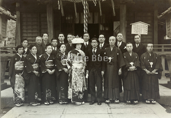 traditional wedding photo in front of shrine Japan 1950s