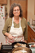 December 2, 2012. Chapel Hill, North Carolina.. Orange County Commissioner Penny Rich prepares traditional Jewish latkes, or potato pancakes, in her home kitchen.