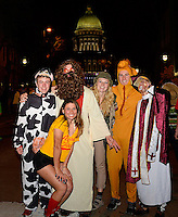 People pose at Freak Ffest with the Madison State Capitol in the background during Freakfest 2015 on State Street in Madison, Wisconsin