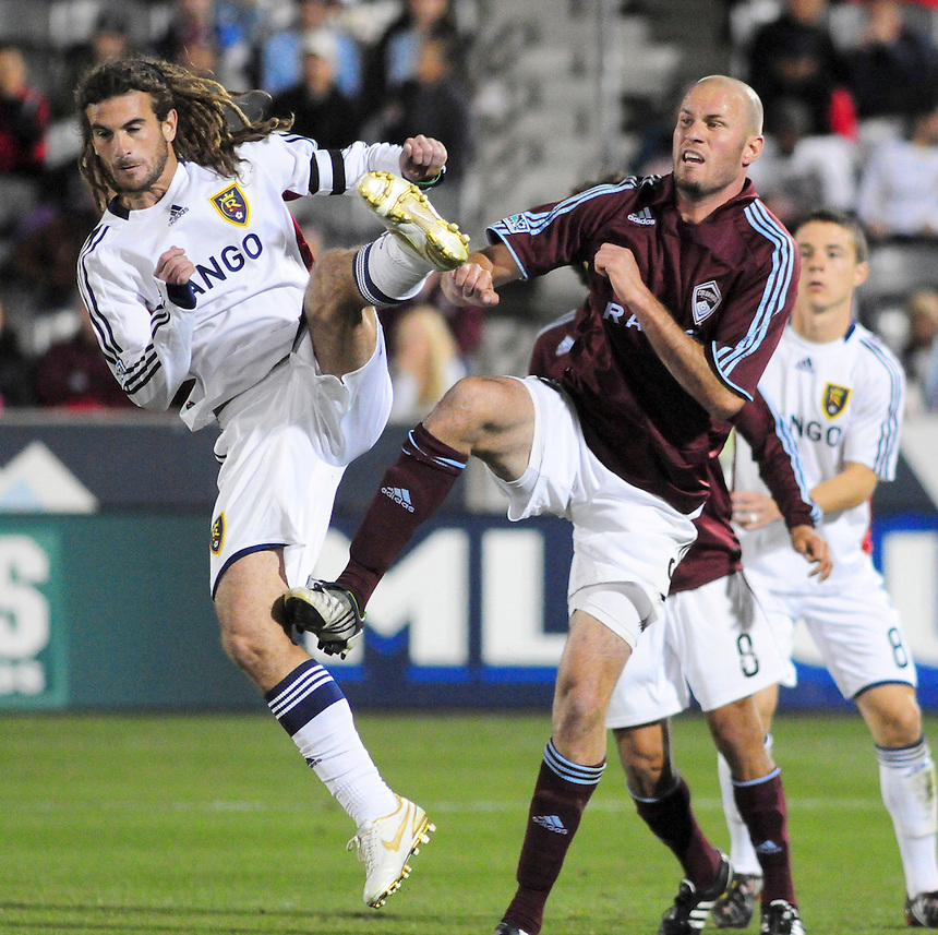 25 October 08: Rapids forward Conor Casey (9) and Real Salt Lake midfielder Kyle Beckerman nearly collide. Real Salt Lake tied the Colorado Rapids at Dick's Sporting Goods Park in Commerce City, Colorado. The tie advanced Real Salt Lake to the playoffs.