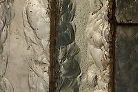 Tropical Rainforest Glasshouse (formerly Le Jardin d'Hiver or Winter Gardens), 1936, René Berger, Jardin des Plantes, Museum National d'Histoire Naturelle, Paris, France. Detail of luminescent glass paste by Auguste Labouret in one of the pillars of the Art Deco style main entrance.