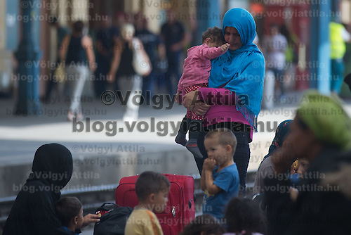 Illegal migrants wait to board train at the main railway station Keleti in Budapest, Hungary on September 03, 2015. ATTILA VOLGYI