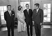 United States President John F. Kennedy, right, meets with Prince Juan Carlos of Spain, center right, and his wife, Princess Sophia of Greece, center left, and Ambassador of Spain, Antonio Garrigues y Díaz-Cañabate, left, in the Oval Office of the White House in Washington, DC on August 30, 1962.<br /> Credit: Arnie Sachs / CNP