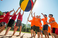 NWA Democrat-Gazette/BEN GOFF @NWABENGOFF<br /> Campers play volleyball with a giant beach ball Tuesday, June 5, 2018, during Bentonville's Camp Memorial at Memorial Park. The five-day camp session for ages 8-12 is part of Bentonville Parks and Recreation's Camp Bentonville program. Campers split into teams to compete in a variety of summer sports and activities each day, including soccer, basketball, scavenger hunts and swimming.