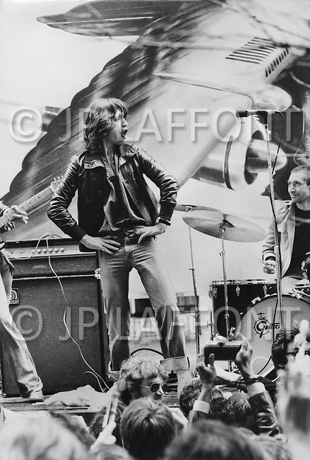 May 1st 1975, 5th Ave, New York City, NY. Mick Jagger, of The Rolling Stones. An instant few minutes concert to announce their new US tour.