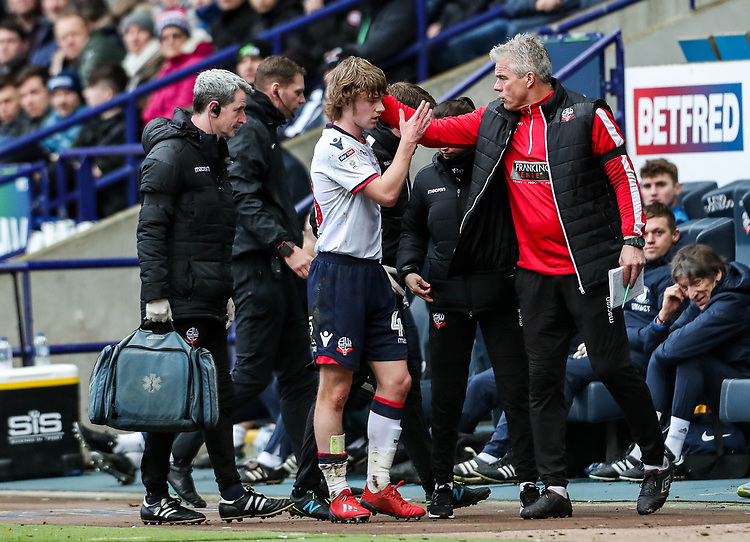 Bolton Wanderers' Luca Connell is comforted by goalkeeping coach Lee Butler after being substituted through injury <br /> <br /> Photographer Andrew Kearns/CameraSport<br /> <br /> The EFL Sky Bet Championship - Bolton Wanderers v Preston North End - Saturday 9th February 2019 - University of Bolton Stadium - Bolton<br /> <br /> World Copyright &copy; 2019 CameraSport. All rights reserved. 43 Linden Ave. Countesthorpe. Leicester. England. LE8 5PG - Tel: +44 (0) 116 277 4147 - admin@camerasport.com - www.camerasport.com