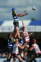 Zach Mercer of Bath Rugby rises high to win lineout ball. West Country Challenge Cup match, between Gloucester Rugby and Bath Rugby on September 13, 2015 at the Memorial Stadium in Bristol, England. Photo by: Patrick Khachfe / Onside Images