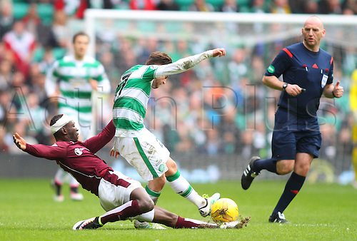 02.04.2016. Celtic Park, Glasgow, Scotland. Scottish Football Premiership Celtic versus Hearts. Patrick Roberts is tackled by Juwon Oshaniwa