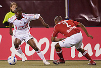Chicago Fire's (10) Thiago is defended by Red Bulls (2) Marvell Wynne during the second half. The Red Bulls played the Fire to a 1-1 tie at Giant's Stadium, East Rutherford, NJ, on May 13, 2006.