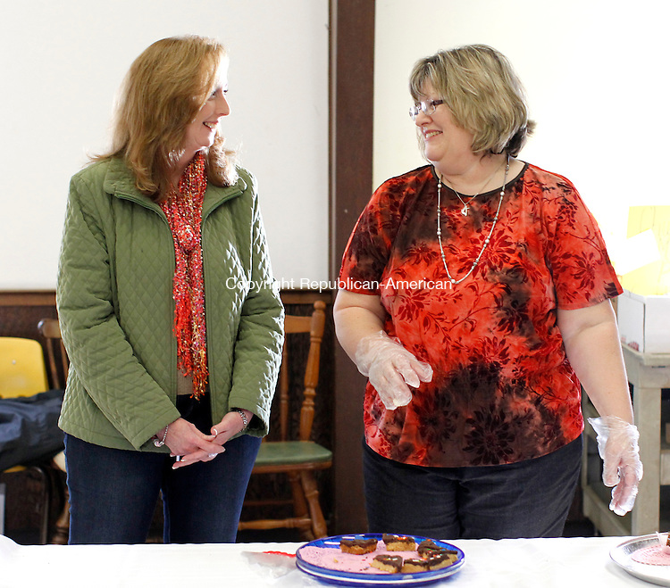Seymour, CT-05 February 2012-020512CM16-   Kathleen Hardman (left) of Seymour chats with volunteer Pam Lauzon who was serving fudge with nuts and peanut butter bars during the 4th annual Chocolate festival at Great Hill United Methodist Church Sunday morning in Seymour.  For 5 dollars, chocolate lovers filled their plates with an assortment of dessert options.  The proceeds will benefit missions and ministry programs for the church, said Reverend Iwy Patel-Yatri. Christopher Massa Republican-American