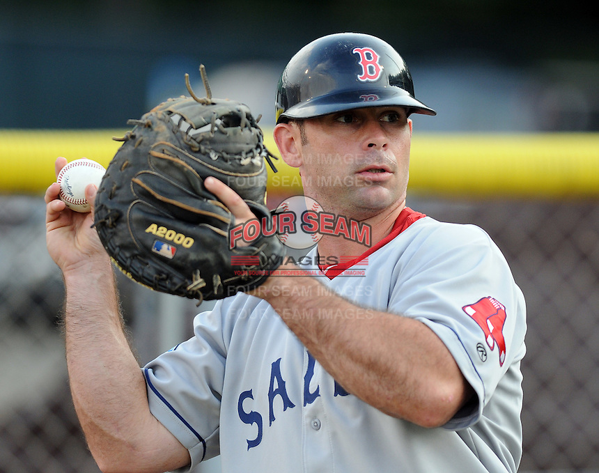 Catcher Dan Butler (12) of the Salem Red Sox, Carolina League affiliate of the Boston Red Sox, prior to a game against the Potomac Nationals on June 16, 2011, at Pfitzner Stadium in Woodbridge, Va. (Tom Priddy/Four Seam Images)