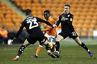 Blackpool's Marc Bola battles with Barnsley's Daniel Pinillos (left) and Mike-Steven B&auml;hre<br /> <br /> Photographer Rich Linley/CameraSport<br /> <br /> The EFL Sky Bet League One - Blackpool v Barnsley - Saturday 22nd December 2018 - Bloomfield Road - Blackpool<br /> <br /> World Copyright &copy; 2018 CameraSport. All rights reserved. 43 Linden Ave. Countesthorpe. Leicester. England. LE8 5PG - Tel: +44 (0) 116 277 4147 - admin@camerasport.com - www.camerasport.com