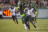 Tampa, FL - September 4th, 2016: South Florida Bulls wide receiver Alex Mut (84) is defended by Towson Tigers cornerback Justice Pettus-Dixon (17) during their match up at Raymond James Stadium in Tampa, FL. (Photo by Phil Peters/Media Images International)