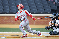 Alex Perry (8) of the Sacred Heart Pioneers follows through on his swing against the Wake Forest Demon Deacons at David F. Couch Ballpark on February 15, 2019 in  Winston-Salem, North Carolina.  The Demon Deacons defeated the Pioneers 14-1. (Brian Westerholt/Four Seam Images)