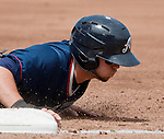 Reno Aces runner Chris Owings dives back into first base against the Fresno Grizzlies during their game played on Sunday afternoon, April 28, 2013 in Reno, Nevada.