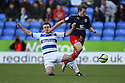Luke Freeman of Stevenage (on loan from Arsenal) is tackled by Jay Tabb of Reading.Reading v Stevenage - FA Cup 3rd Round - Madejski Stadium,.Reading - 7th January, 2012.© Kevin Coleman 2012