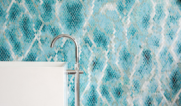 Waterweb, a hand-cut glass mosaic shown in Tanzanite, Chrysocolla, Alexandrite, Feldspar, Aquamarine, Absolute White, Opal, Moonstone, Serpentine, Turquoise, and Amazonite Sea Glass™, is part of the Broad Street™ collection by New Ravenna.<br /> <br /> Tub courtesy of Badeloft<br /> www.badeloftusa.com