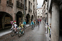 peloton rolling through town<br /> <br /> Stage 18: Valdaora/Olang to Santa Maria di Sala (222km)<br /> 102nd Giro d'Italia 2019<br /> <br /> ©kramon