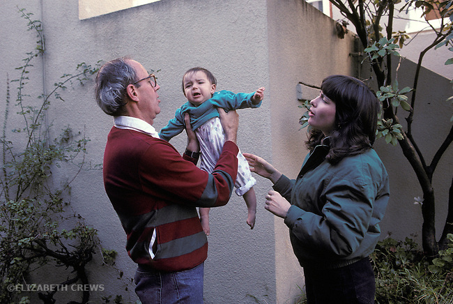 Berkeley CA Baby showing stranger/separation anxiety in unfamiliar hands  MR