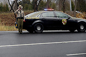 A Maryland State Trooper salutes as United States President Donald J. Trump's motorcade heads to Walter Reed National Military Medical Center for his annual physical examination January 12, 2018 in Bethesda, Maryland. Trump will next travel to Florida to spend the Dr. Martin Luther King Jr. Day holiday weekend at his Mar-a-Lago resort. <br /> Credit: Chip Somodevilla / Pool via CNP