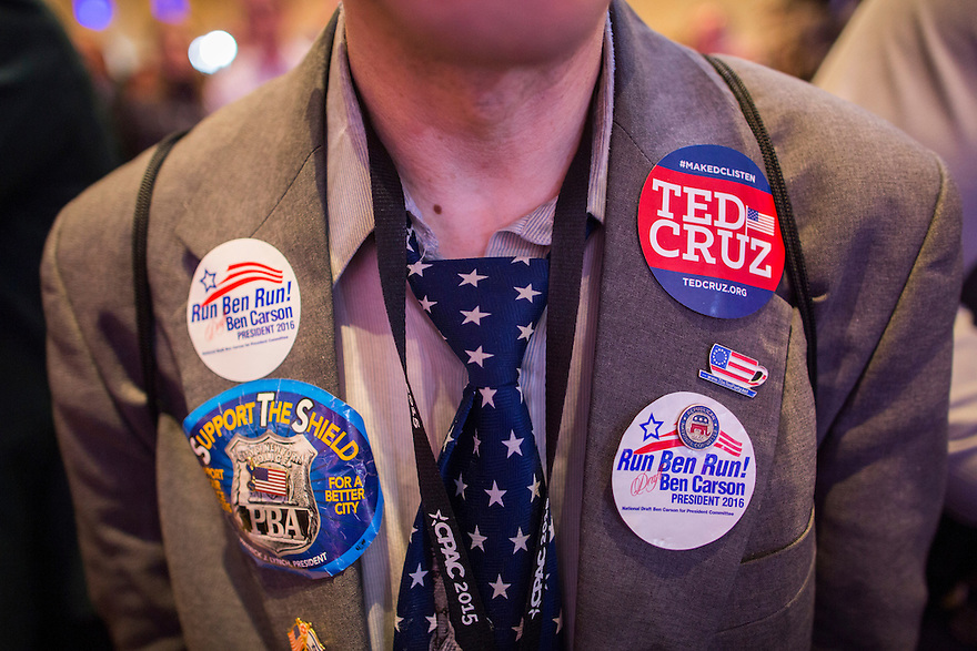 A supporter with political buttons and pins attends the 2015 Conservative Political Action Conference (CPAC) outside Washington, DC