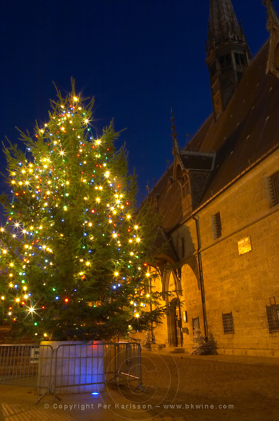 A Christmas tree with coloured colored lights in front of the Hotel Dieu Hospices de Beaune in Beaune Cote d'Or Burgundy Bourgogne France Europe
