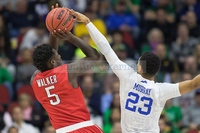Guard Jamal Murray of the Kentucky Wildcats blocks guard Ahmad Walker of the Stony Brook Seawolves during the NCAA Tournament first round game at Wells Fargo Arena on Thursday, March 17, 2016 in Des Moines, Iowa. Photo by Michael Reaves | Staff.