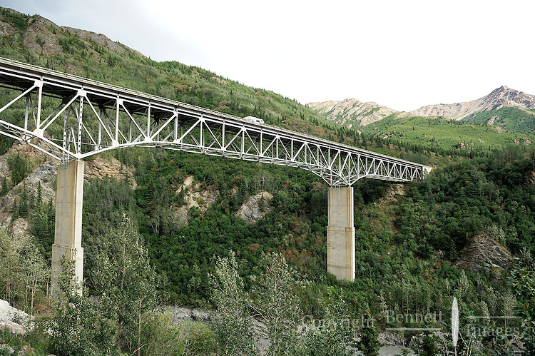 The Alaska Railroad's Denali Star train prepares to go under the Parks Highway at the entrance to the Nenana Canyon.