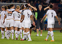 USWNT head coach Pia Sundhage celebrates with her team after playing at Worker's Stadium.  The USWNT defeated Japan, 4-2, during the semi-finals of the Beijing 2008 Olympics in Beijing, China.