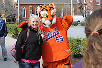 The Clemson Tiger mascot poses for a photo before the first ever Tiger Walk prior to the Reedy River Rivalry game against the Clemson Tigers on March 1, 2014, at Fluor Field at the West End in Greenville, South Carolina. South Carolina won, 10-2. (Tom Priddy/Four Seam Images)